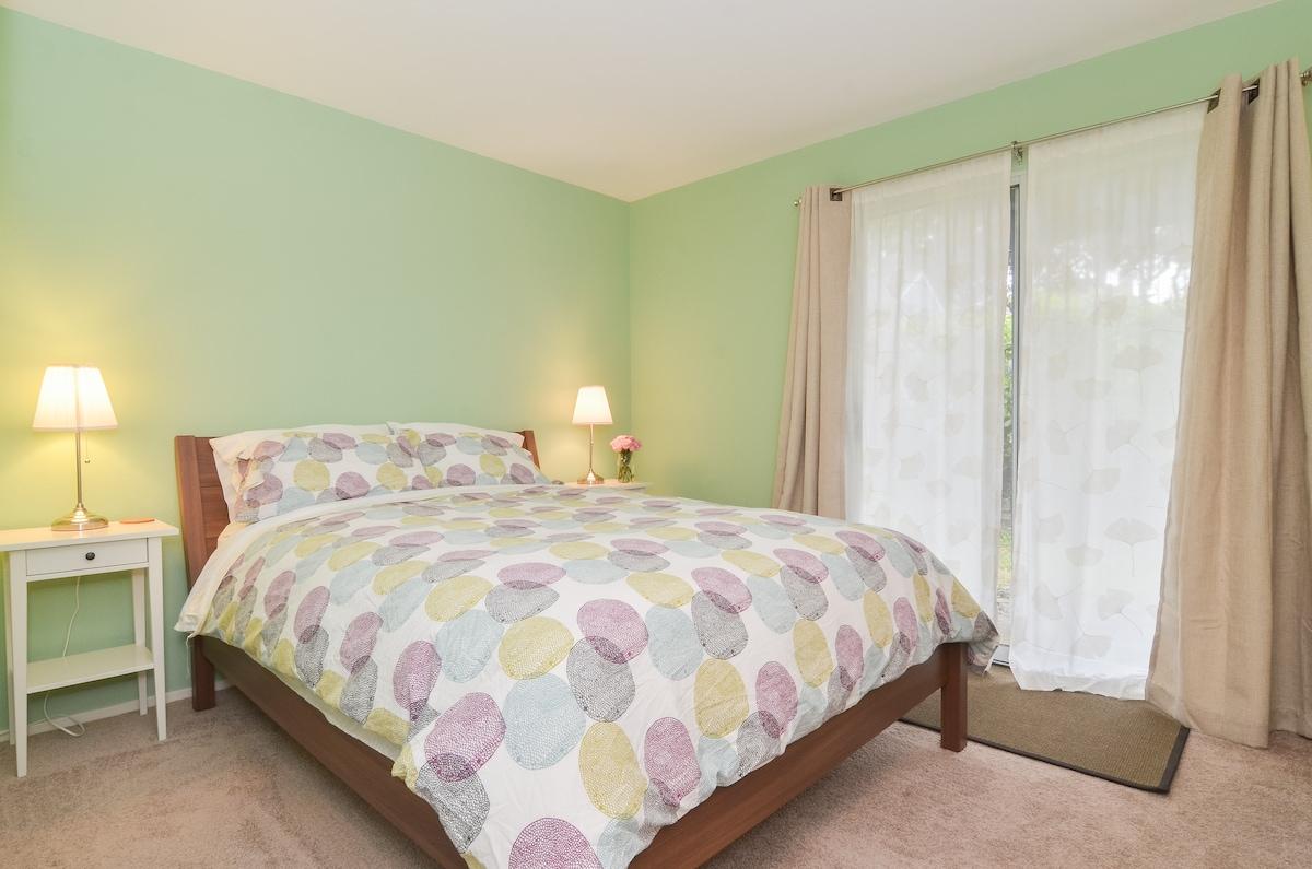 Comfy queen size bed in bedroom.