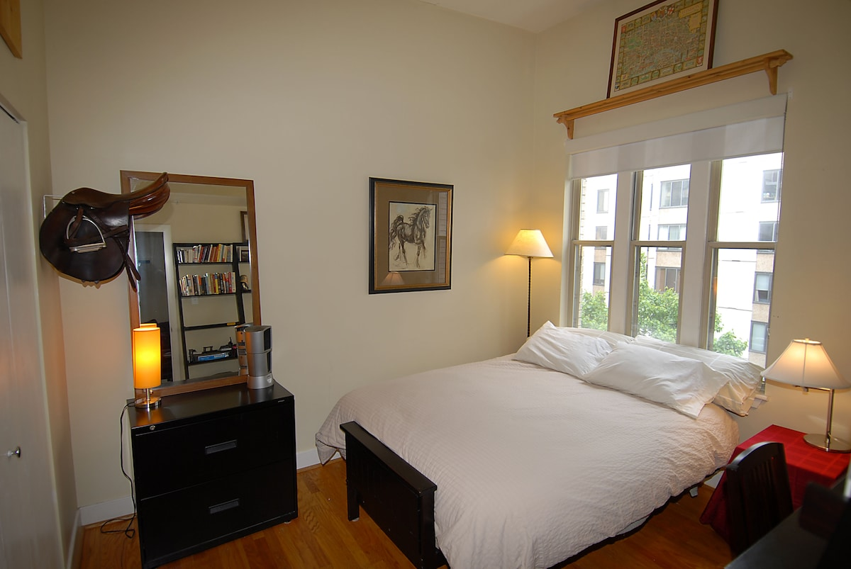 Your lovely room! Comfy, cool, great light, hardwood floors.
