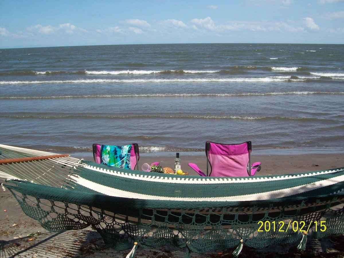 Hammocking on the beach in Santa Cruz at Linda Guest House - your reservation is a donation towards our local educational and environmental projects.