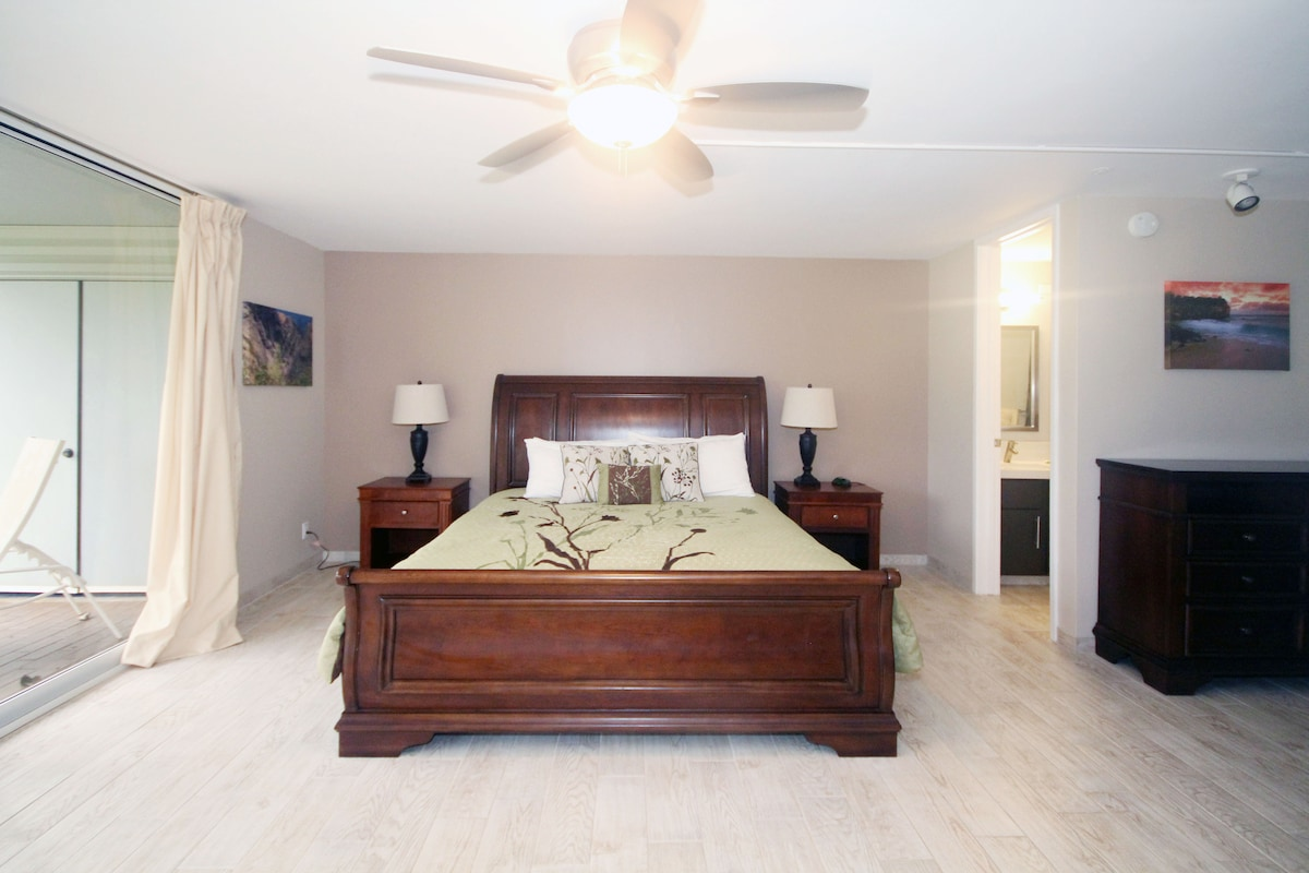 Master bedroom with ceiling fan.