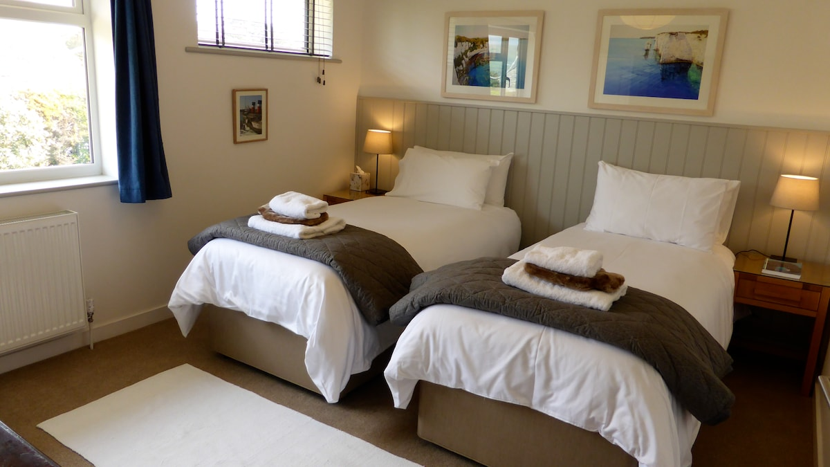 """Guest Wing Bedroom (2) with two large single Hypnos beds that can be zipped together to be a Super Kingsize bed. Invite your friends at £25 p.p.n 32"""" TV & DVD"""