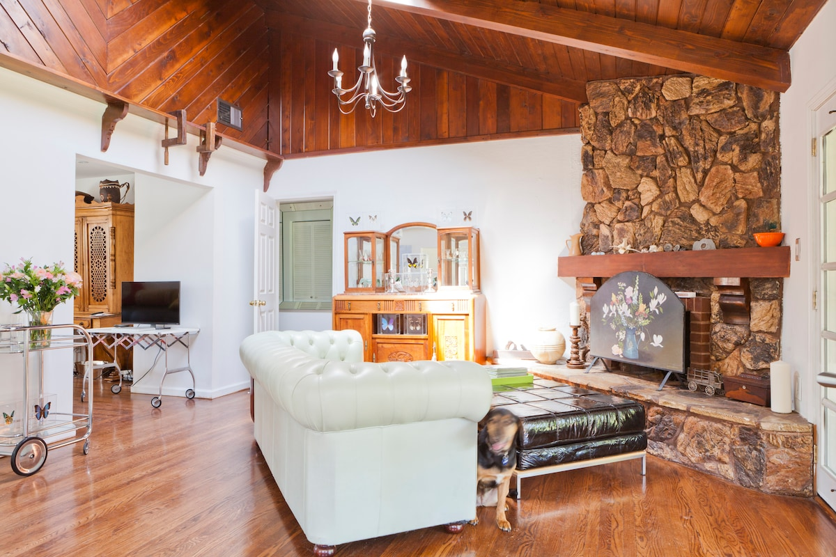 Living room with stone fireplace Unlimited wood!
