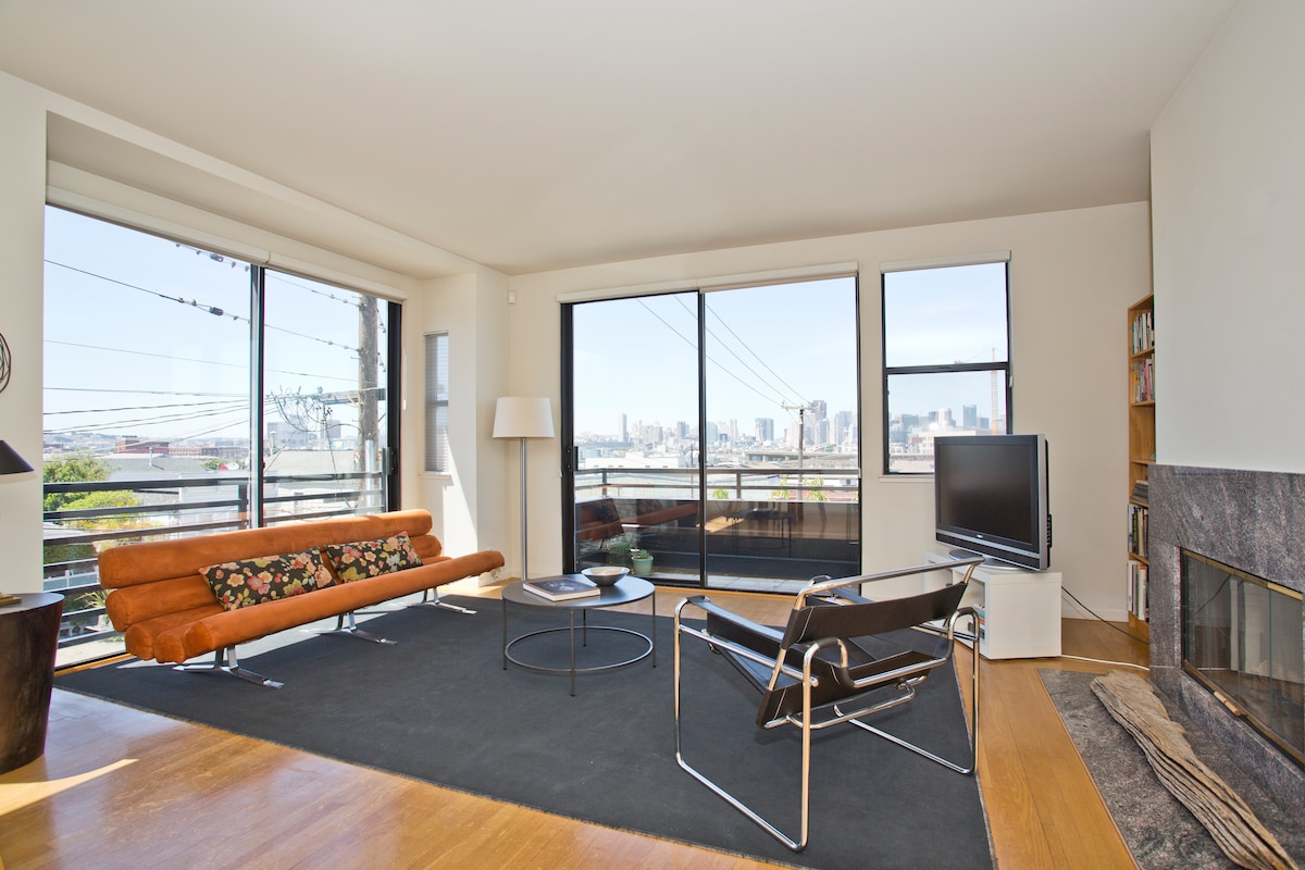 Open space living room with skyline views
