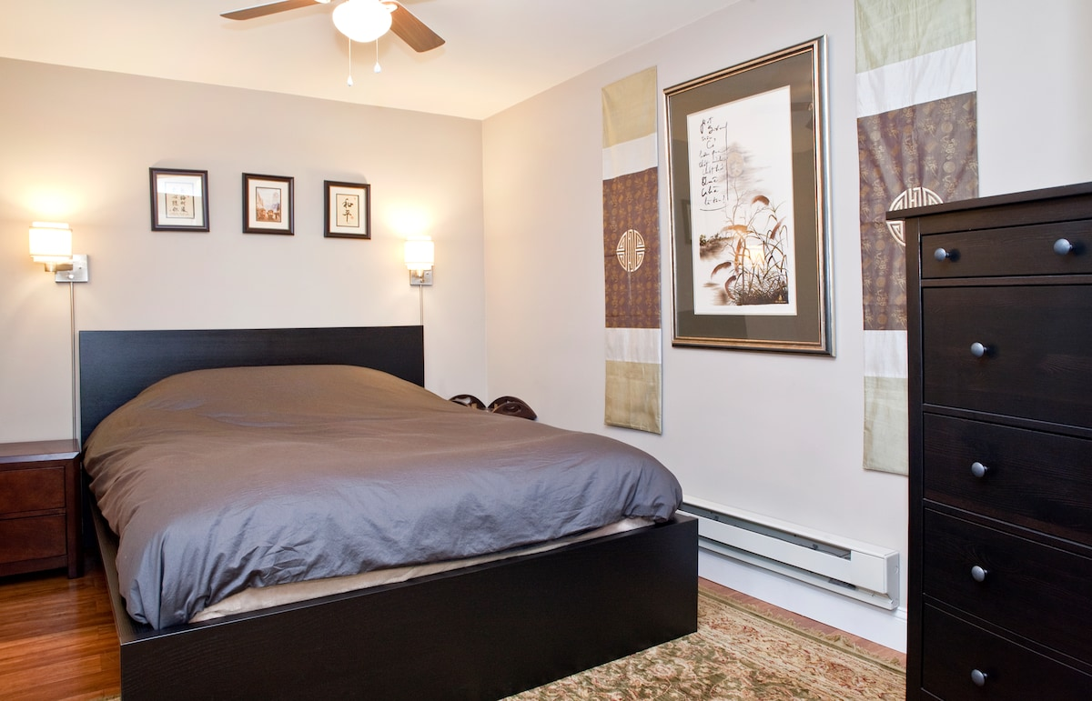 Bedroom includes queen size bed, dresser, night tables, and closet.