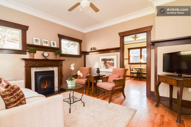 Living spaced graced with a carved cherry mantel...a comfortable and inviting spaces,
