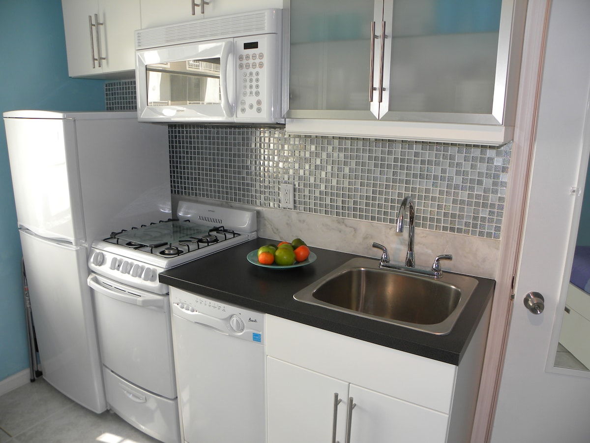 Our kitchen contains a deep sink, dish washer, 4 burner gas stove and oven, microwave/fan and a full sized  fridge.