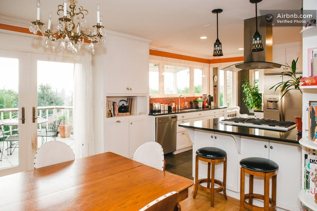 Our open kitchen/dining area abuts a sweeping view deck.  Enjoy the hot tub on cool nights.  Or go for a dip and watch the Sunset over amazing territorial, city, Olympic mountain, and Puget Sound views!