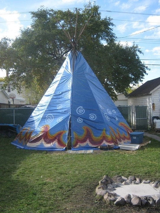The tipi, erected in October 2013 so we could have warm fires all winter - woo hoo! (Sadly, wind blew off most of the paint over the winter - time to re-decorate!)