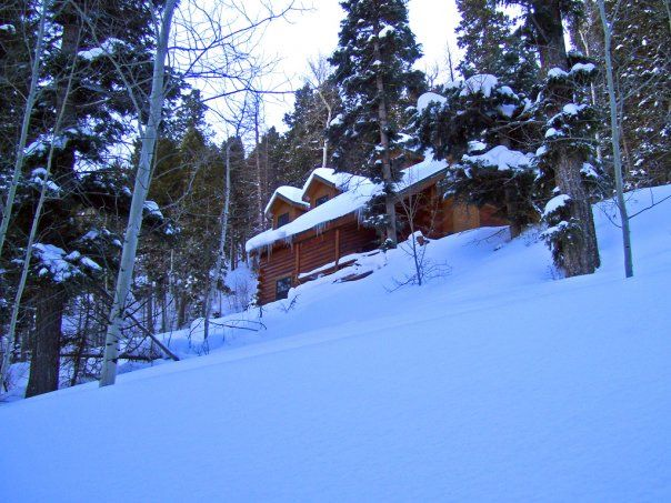 Front of the cabin in winter.  Snows can get up to five feet deep.  Great for sledding, snowshoeing or cross country skiing in the meadow below.