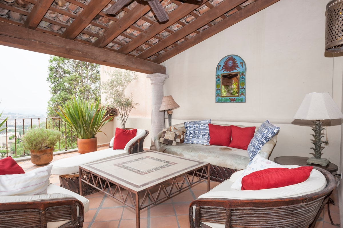 """Rooftop """"azotea"""" sitting area, with traditional techo tile roof"""