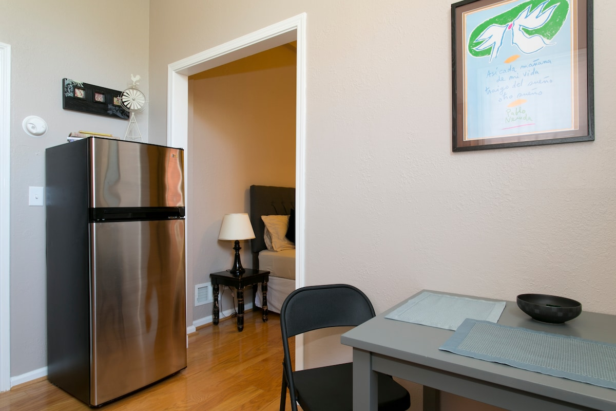 10 cubic foot stainless steel refrigerator. *Kitchen table and chairs have been replaced with a bistro table & 2 leather chairs.