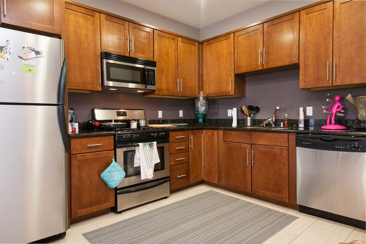 Kitchen with granite counters and stainless appliances.