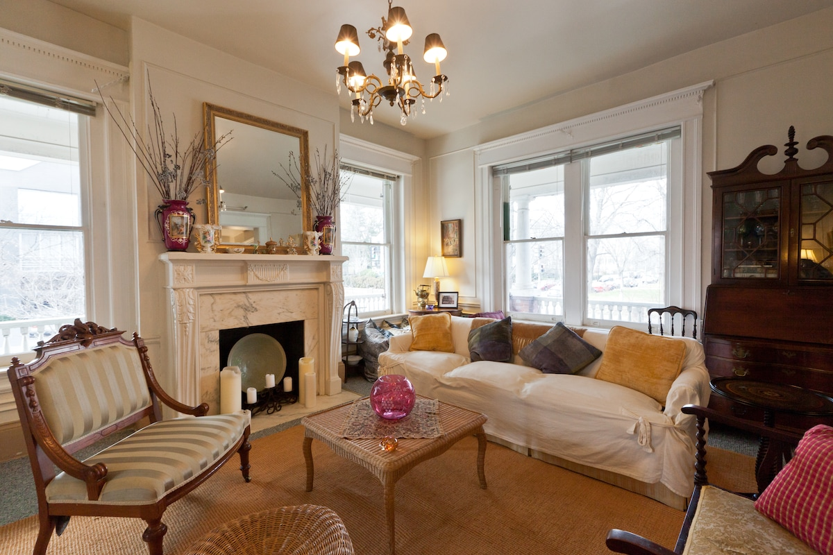 Gather and relax in our double parlor furnished with antiques and curios.