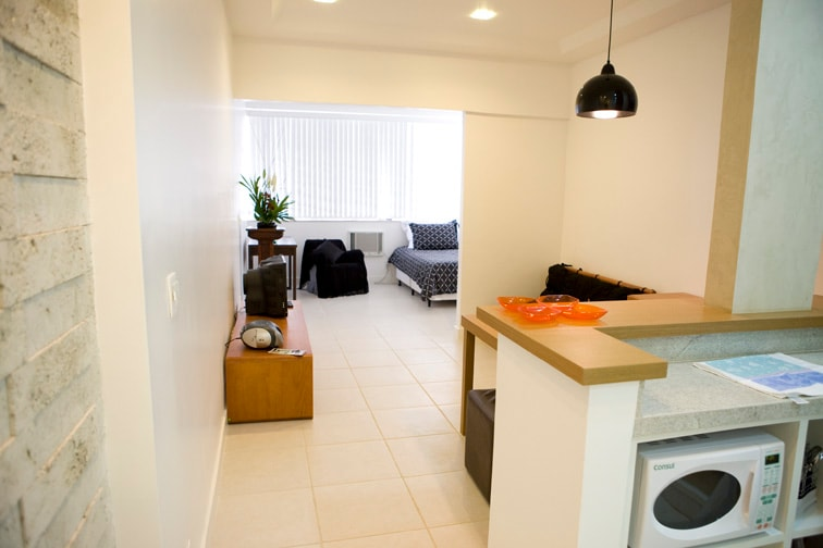 apartment entrance w kitchen living and bedroom on background