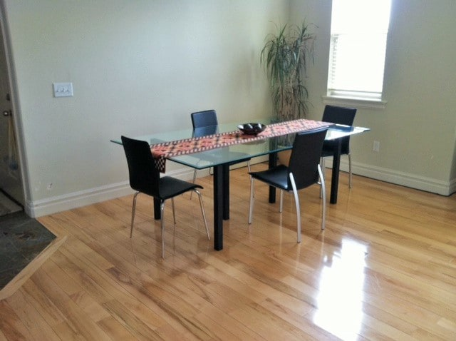 Large dining room table with room for 6 people, plus a breakfast bar for 2 more