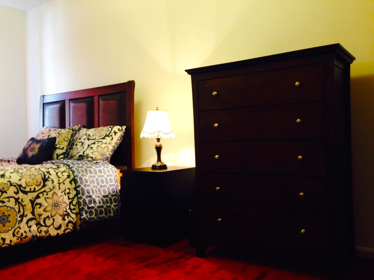 Large designer 5 drawer dresser with matching bed frame; brand new mattress and high thread count linens