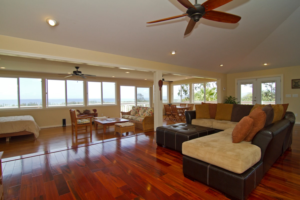 The roomy Living room and family room with Tiger Wood floors.