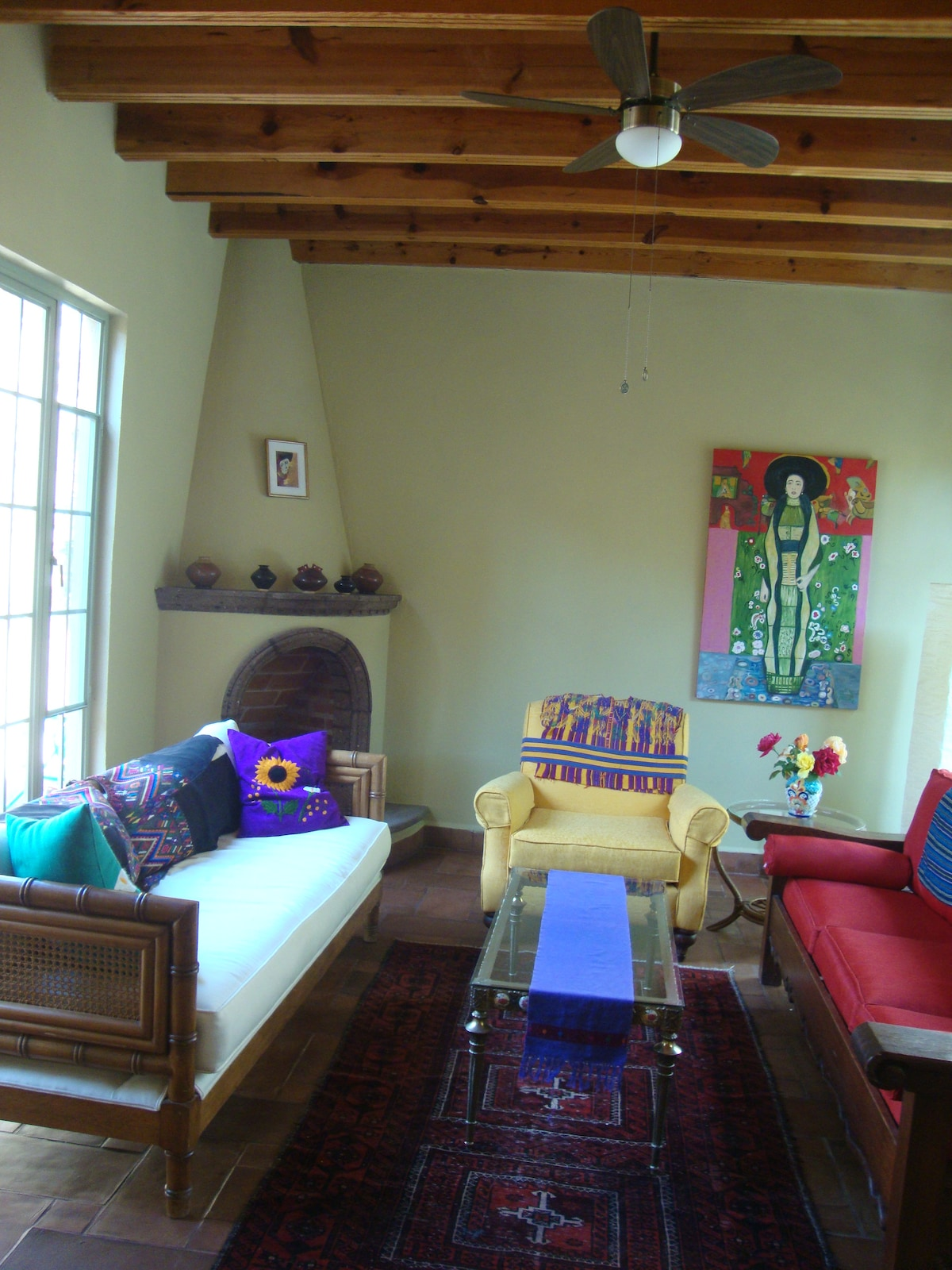 Mexican fireplace and comfortable furnishings in the 'sala' or living room.  San Miguel de Allende Home.
