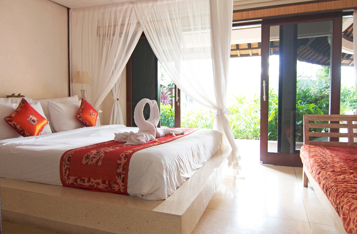 The 4 bedrooms in the villa open on to the wide verandah with garden and pool views.