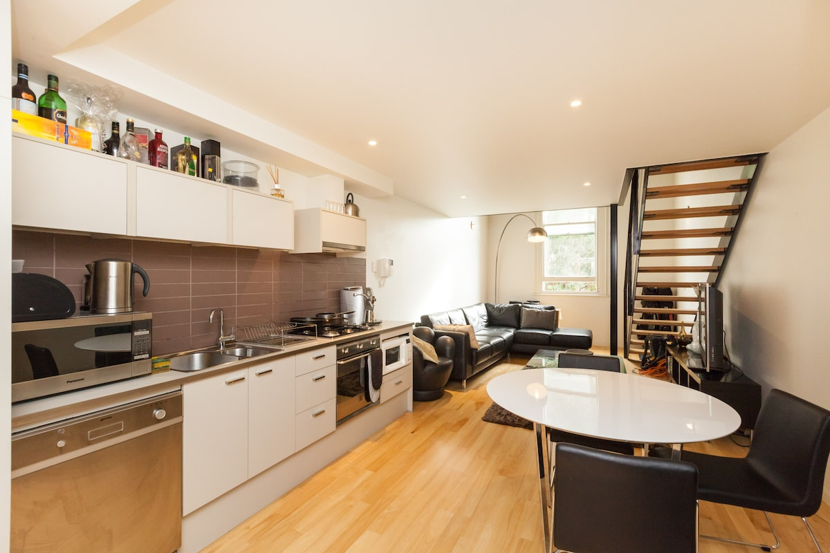 A fully decked & equipped kitchen and dining area.