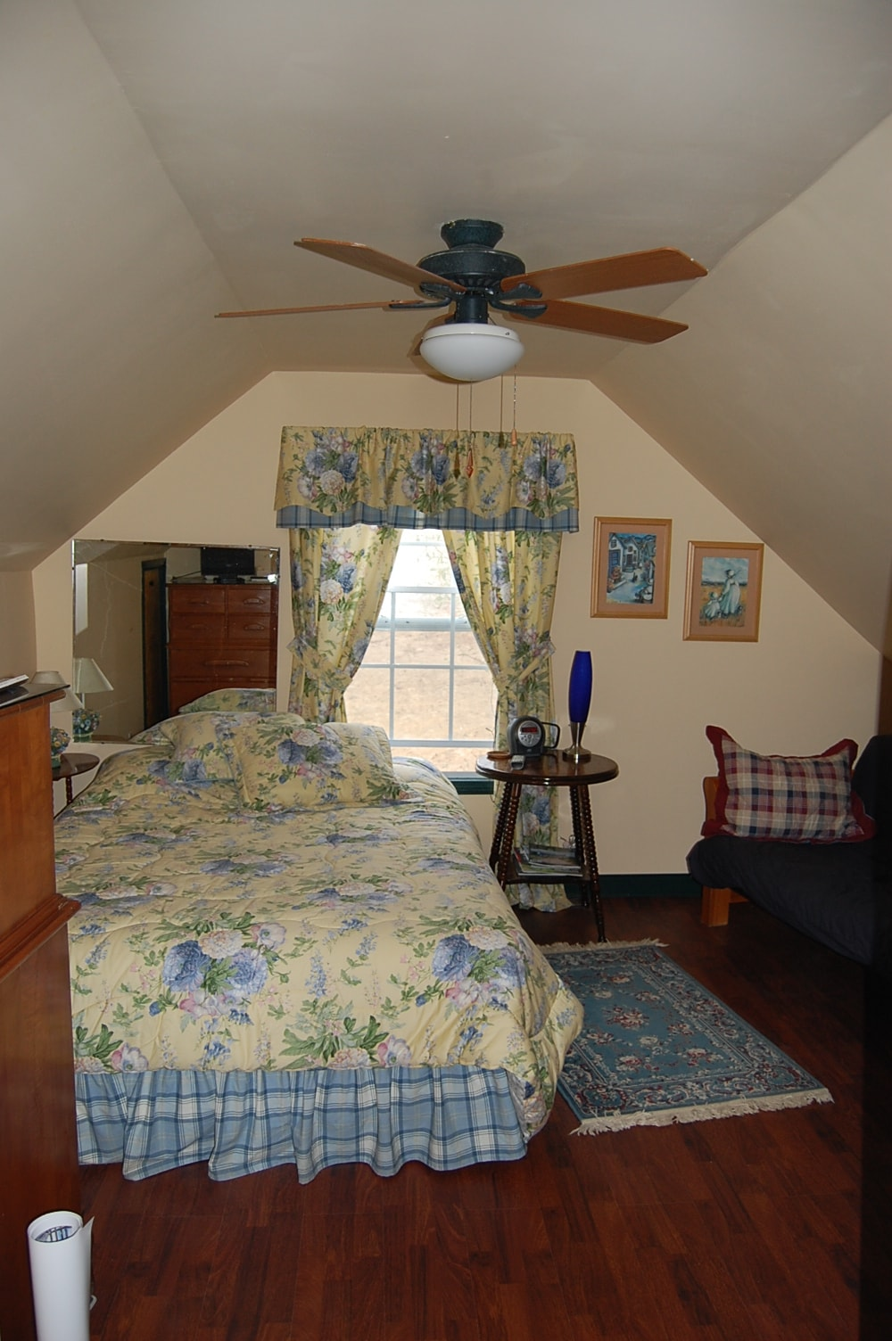 Bedroom with queen bed and double futon couch/bed
