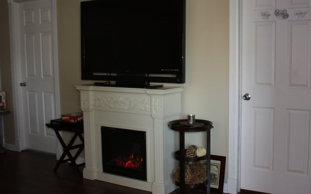 """55"""" TV, fireplace with heat control and timer."""