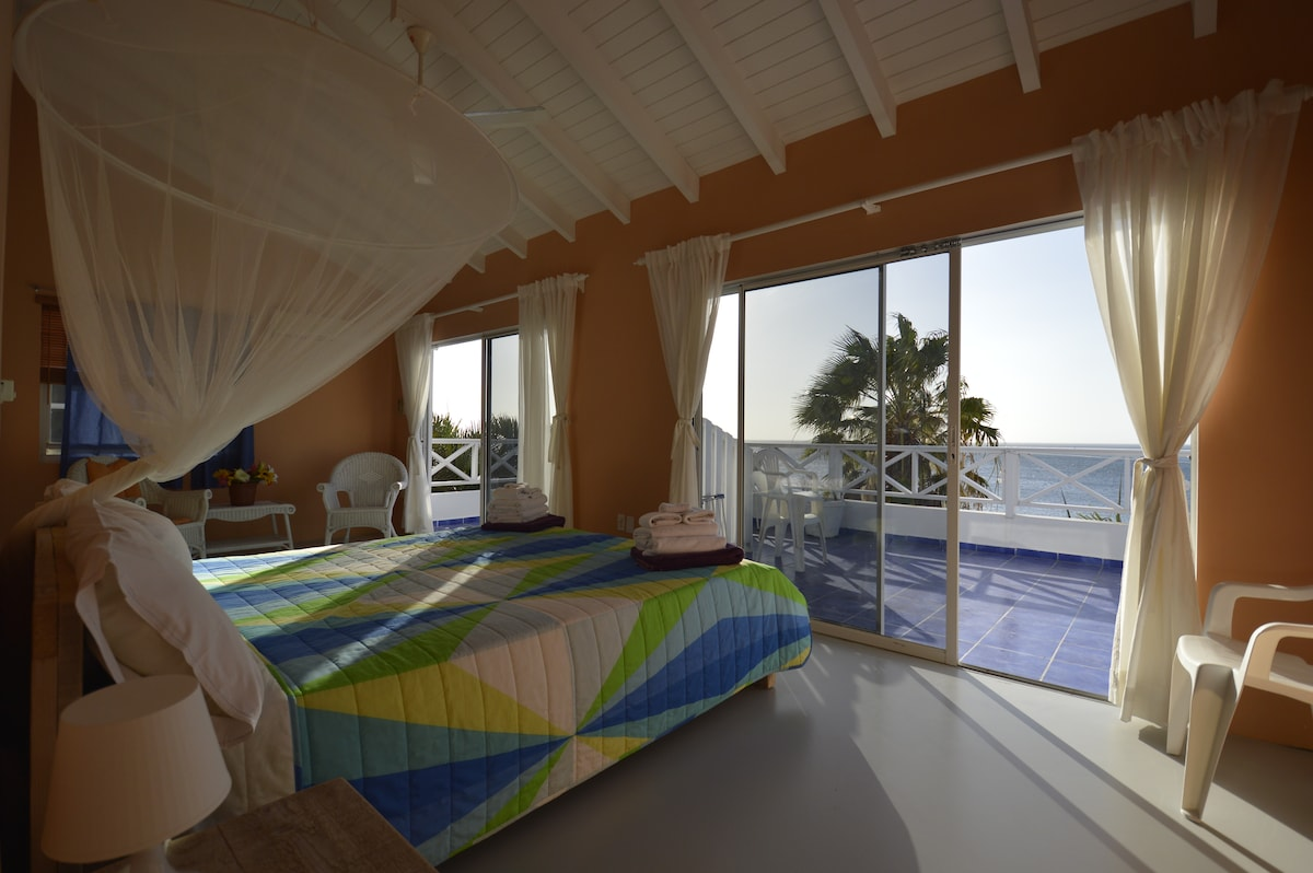 Bedroom and king size bed with a view on the first floor.