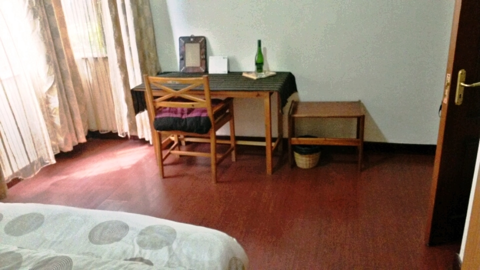 We've added a small mirror, a desk calendar, an extra chair cushion, and a side table where you can unpack your luggage.