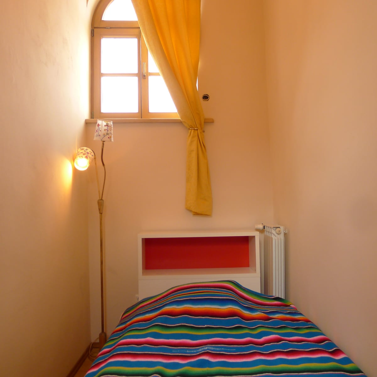 One of two places to sleep. Door on your left to the small bedroom, ( bed 140 cm x 200 cm) with arch window