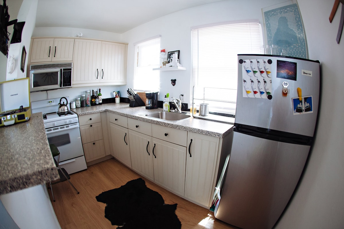 Updated kitchen with coffee maker, teas, cooking oils and all you need to cook a gourmet meal.