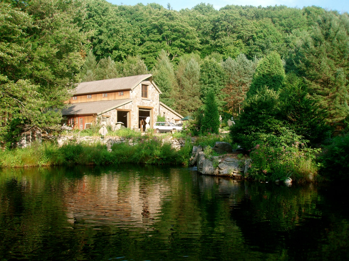Our main stone barn, just a stone's throw away, houses our Yoga Room, Guest Kitchen and Ping Pong Table.