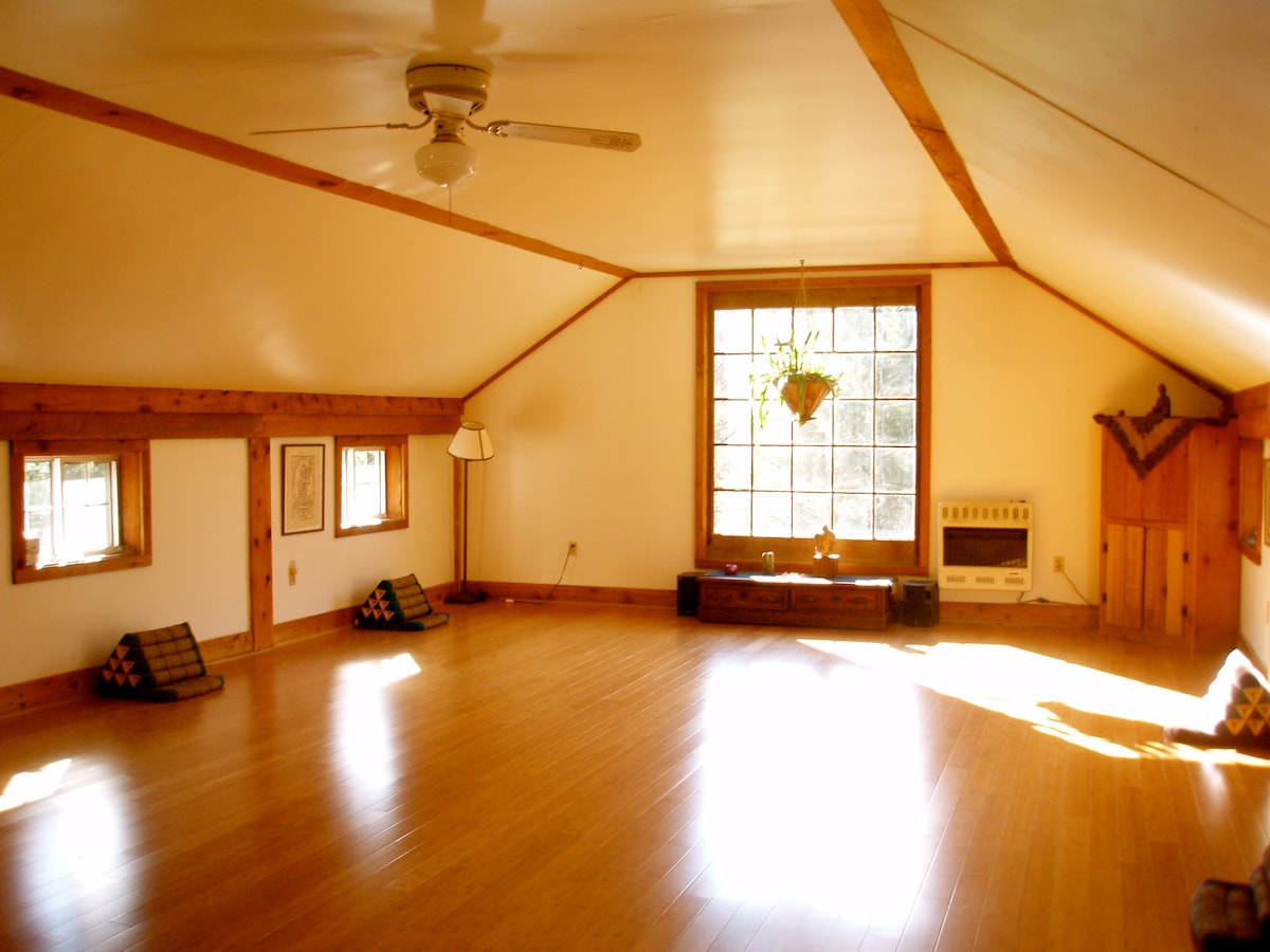 Our Yoga Studio, with a view of the pond and bamboo floors is located in our Stone Barn