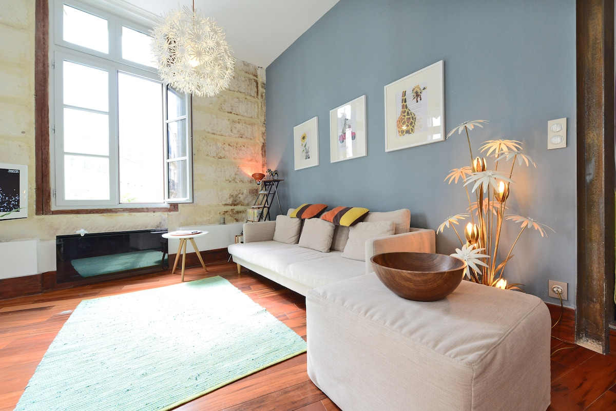 the light and airy lounge area with contemporary sofa and artwork