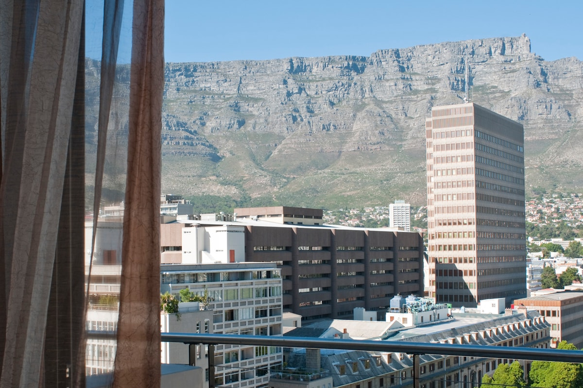 View of Table Mountain from balcony and open-plan living area.