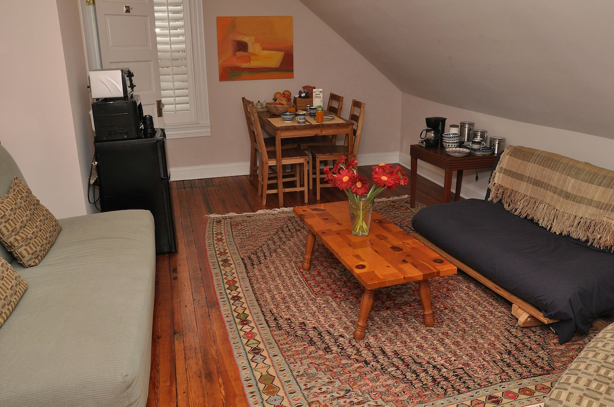 Your own living/dining room in the Perch Suite. Futon sleep two and couch can sleep one more.