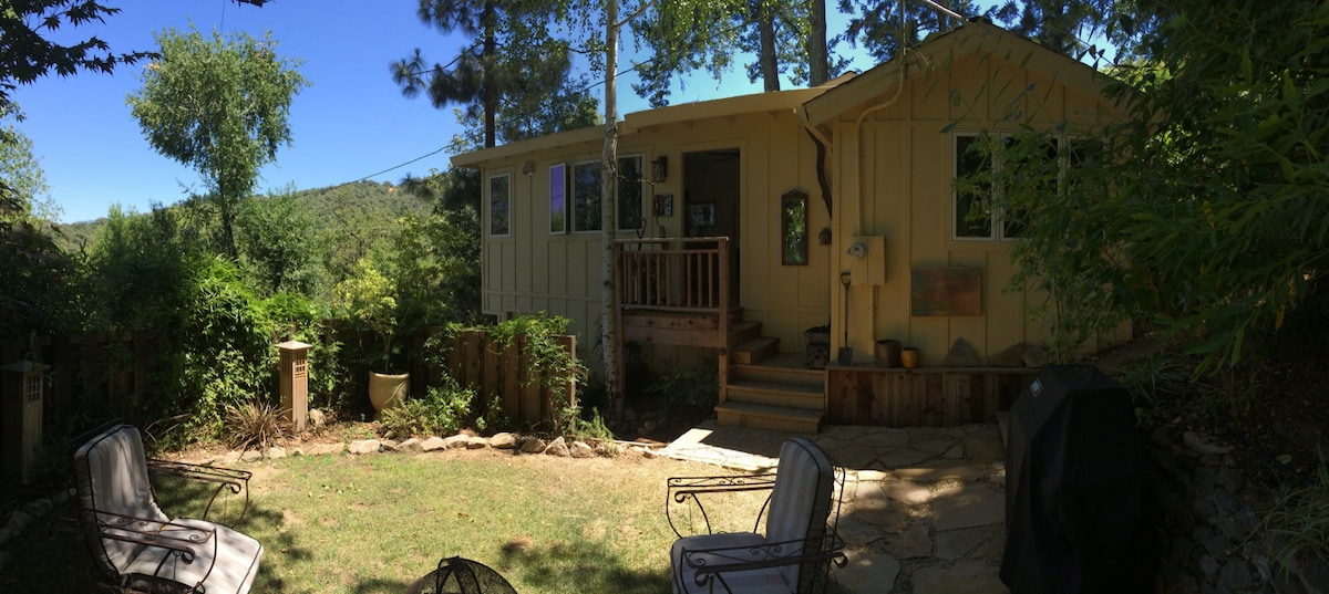 The cabin seen from the private, enclosed garden area.
