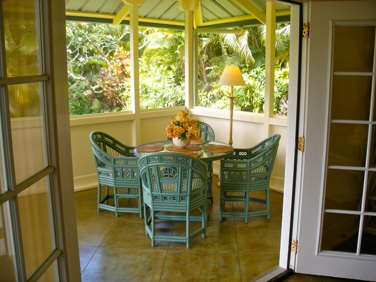 French doors open to the dining table in the breezy lanai