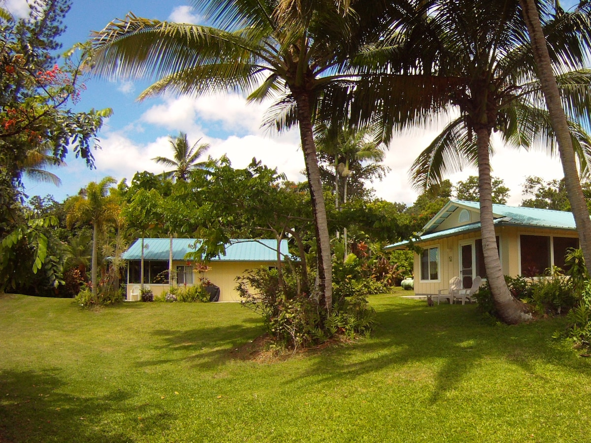 The Bamboo Cottage is on the right, and the Palms Cottage is on the left