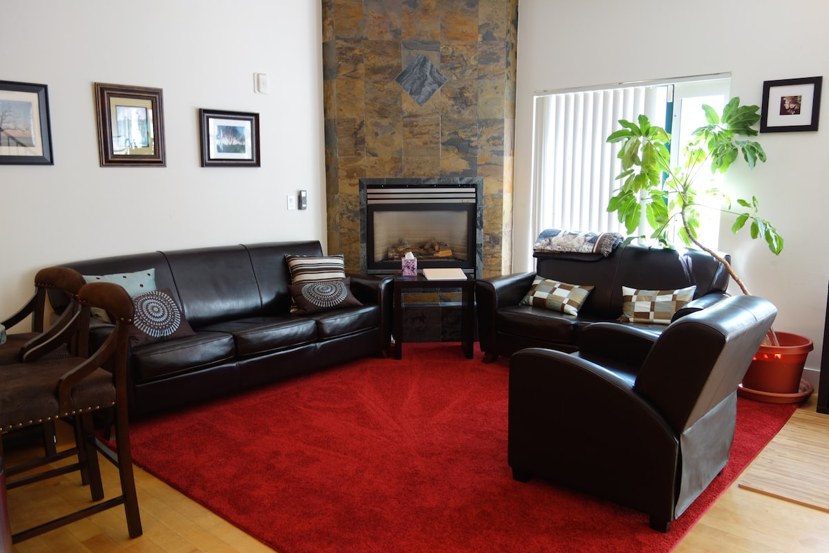 We updated the living area furniture and got new carpet. There's a working fireplace and overhead fan.