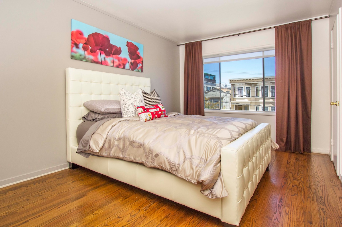 Spacious bedroom is light and bright, but also has window treatments and shades if you want to sleep in! Large comfy bed with hotel style bedding. Plenty of extra pillows, window bench and two large closets.