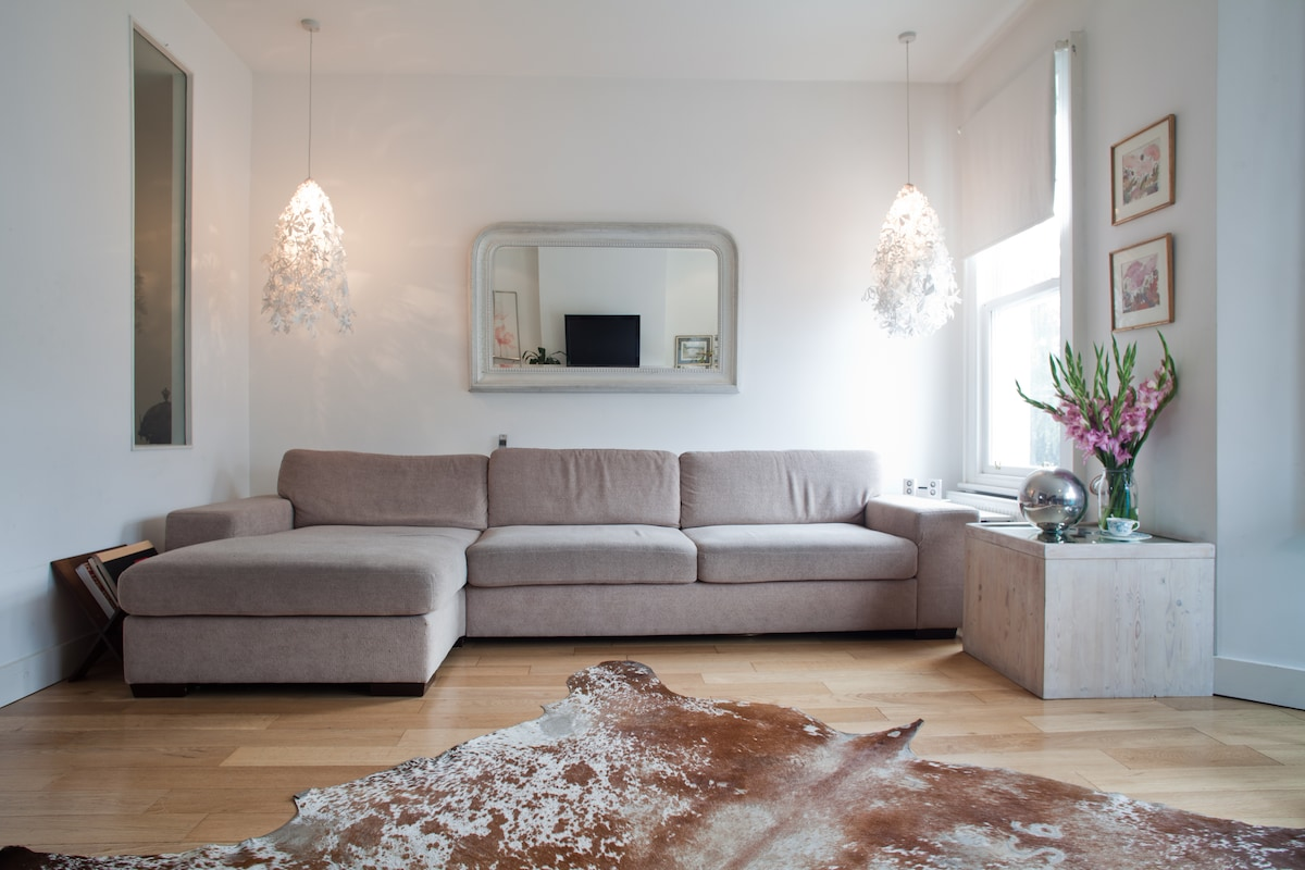 Living Room - large with comfortable seating for 8 to relax in after a day in the city - 24 sqm