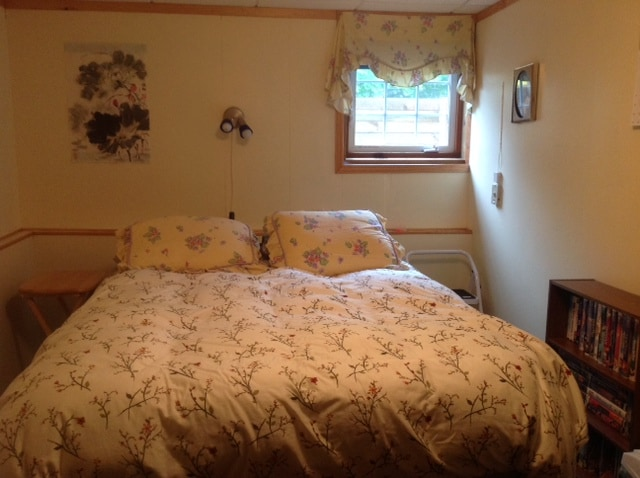 Queen, pillowtop bed in an extra large bedroom-reading light, closet, chest of drawers etc..
