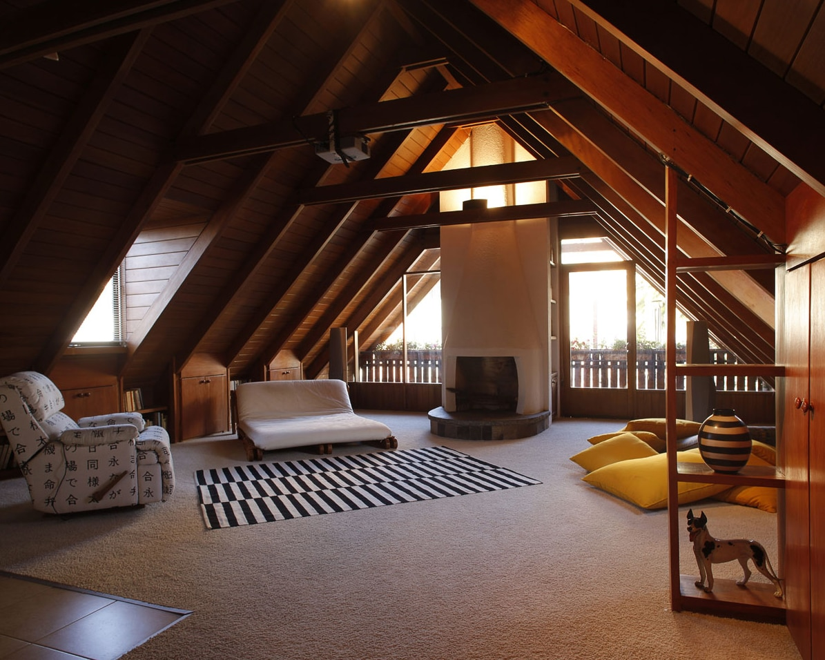 The living room is  spacious. The beautiful hard-wood roof makes it very cozy and elegant.