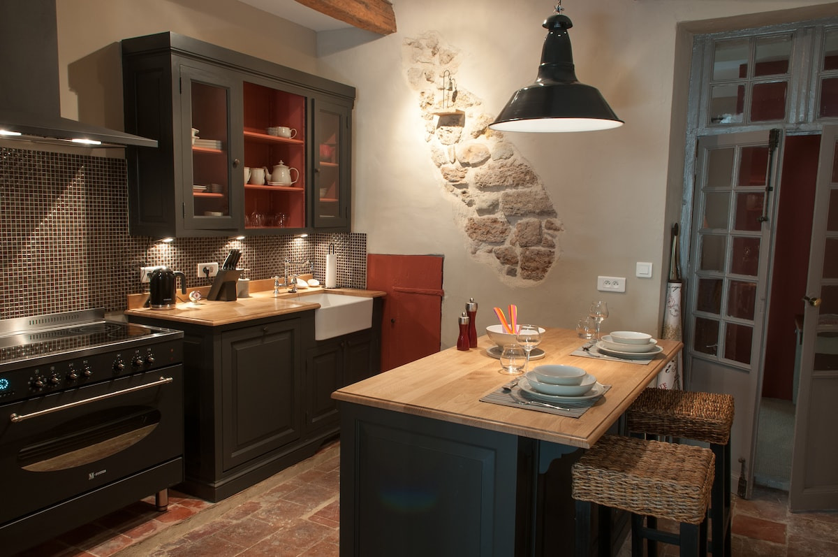 Lovely custom design kitchen with a hint of original stone wall.