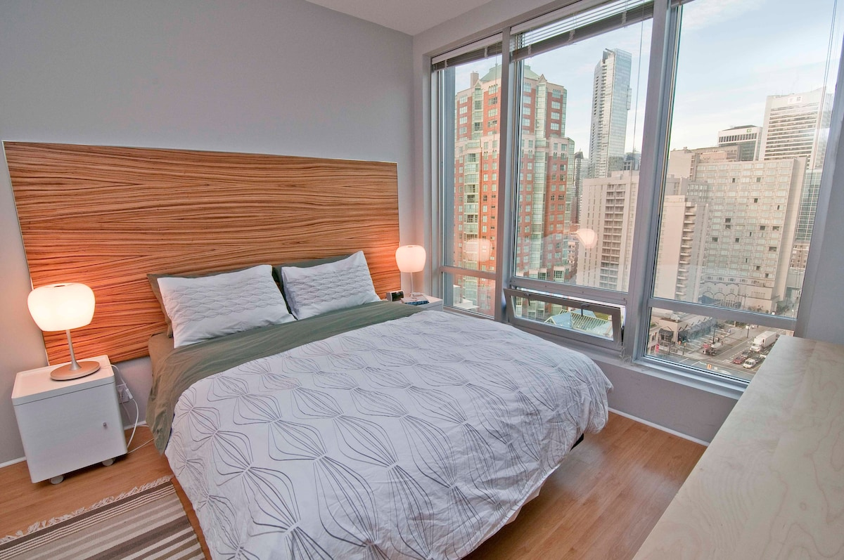 A comfortable queen-size bed with a breathtaking view