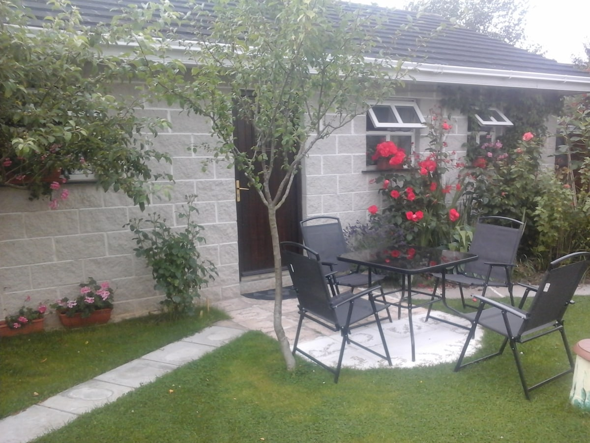 Relax outside the rose cottage with the smell of roses