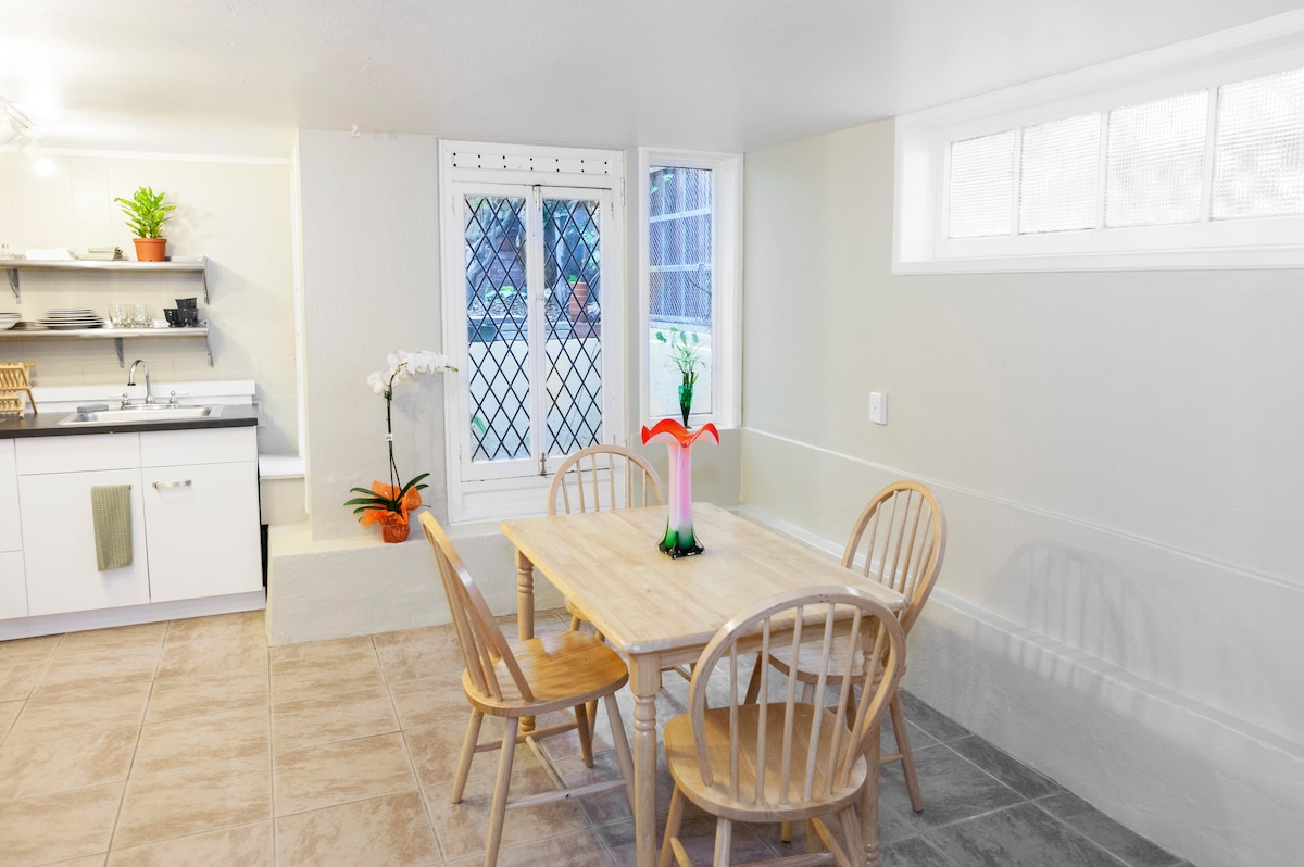 """Dining"" area in the kitchen with beautiful old window."