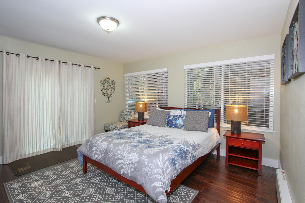 Spacious master bedroom with Queen bed, opens to wrap around deck.