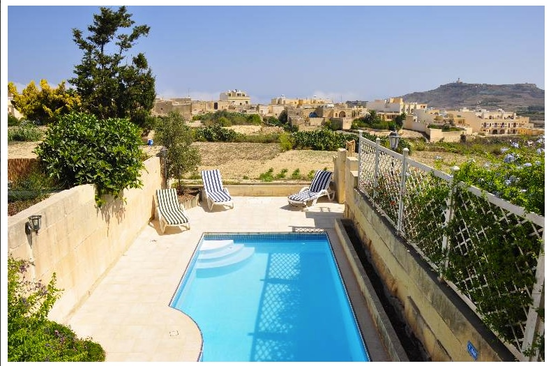 View from First Floor of Pool Deck and Swimming Pool.
