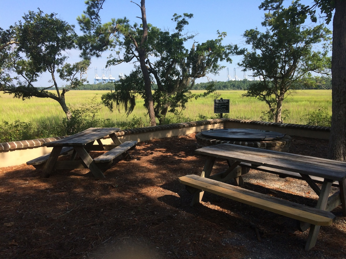 Fire pit and picnic tables on the marsh walk